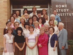 Delmer Holbrooke, right, posing with the Home Study Institute team. Photo: Charlotte Conway.